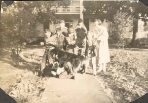 """""""Man"""" the collie dog is trouncing on someone, and there's a real good chance it's me. The Barker House is in the background."""
