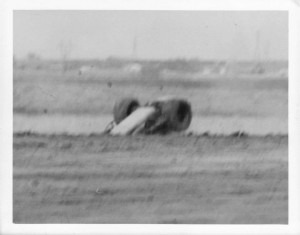 Look closely and you can see dirt clods still flying through the air. This picture was snapped from the infield by fellow racer Don Johnson's father.